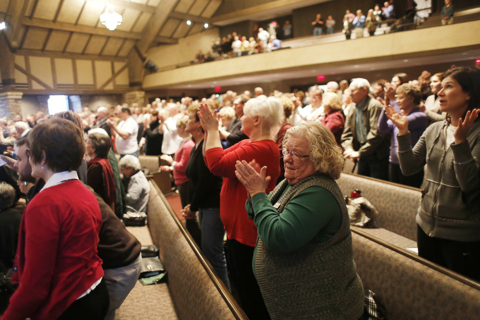 Photo - Some members of First Presbyterian Church of Edmond applaud Sunday after hearing an announcement that the congregation had voted to sever ties with the Presbyterian Church (USA) denomination.   DOUG HOKE - THE OKLAHOMAN