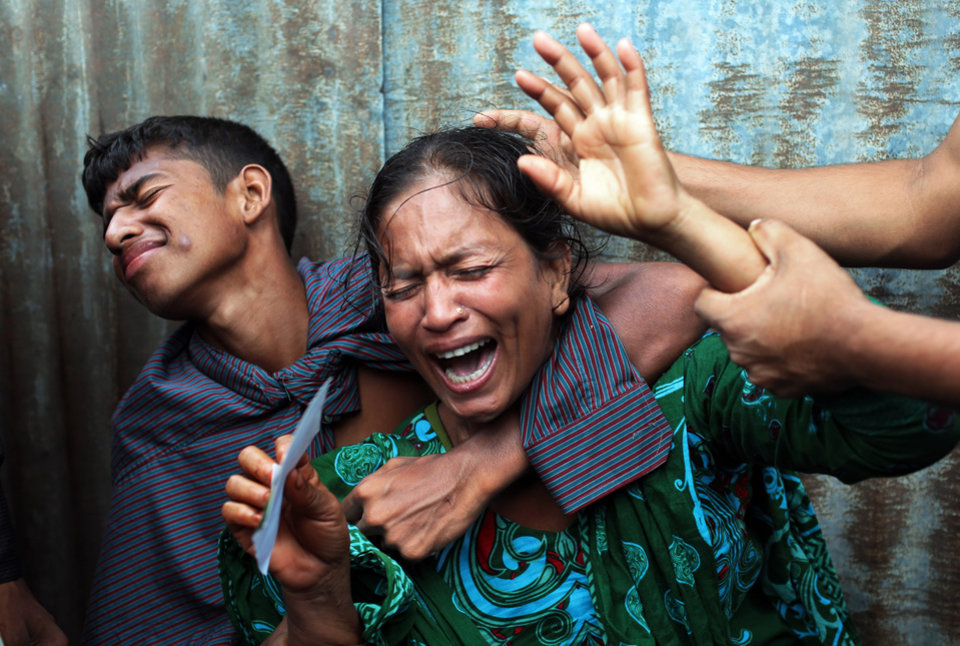 Photo - AP10ThingsToSee - Bangladeshi woman Munni, whose daughters are missing, cries as rescuers search the River Padma after a passenger ferry capsized in Munshiganj district, Bangladesh, Monday, Aug. 4, 2014. (AP Photo/ A.M. Ahad)