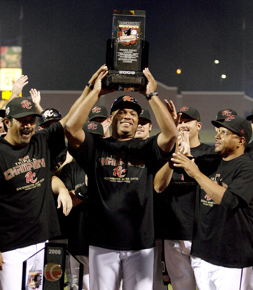 Sacramento manager Todd Steverson raises the championship trophy after Sacramento's win over Scranton 4-1 in the Triple-A Championship game at the AT&T Bricktown Ballpark in Oklahoma City, Tuesday, September 16, 2008. BY BRYAN TERRY, THE OKLAHOMAN