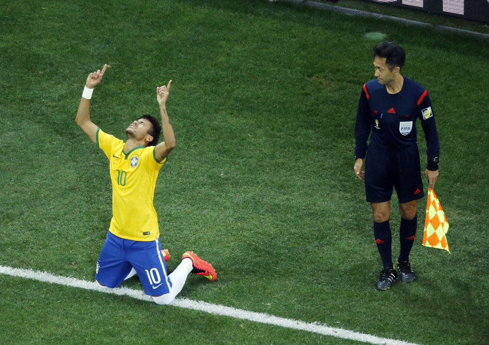 Photo - Referee Yuichi Nishimura from Japan watches as Brazil's Neymar celebrates his second goal on a penalty kick during the group A World Cup soccer match between Brazil and Croatia, during the opening game of the tournament, in the Itaquerao Stadium in Sao Paulo, Brazil, Thursday, June 12, 2014. (AP Photo/Fabrizio Bensch, Pool)