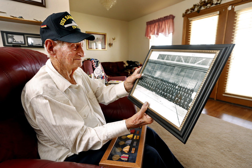 Photo - Dow Meek, a 97-year-old Navy veteran of the Pacific theater, talks about his experiences in WW2 on Thursday, Nov. 10, 2016 in Rush Springs, Okla.  He recently received a photograph taken before his departure of he and his shipmates.  Photo by Steve Sisney, The Oklahoman
