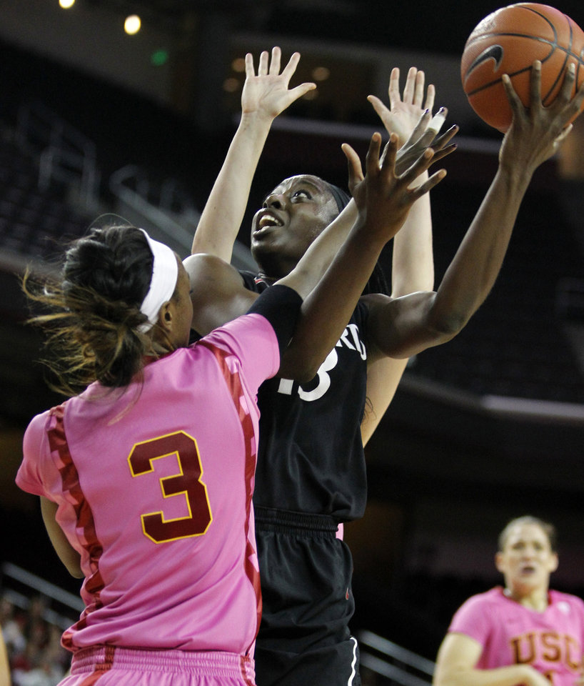 Photo - Stanford forward Chiney Ogwumike, right, shoots the ball against Southern California forward Desiree Bradley (3) during the first half of an NCAA college basketball game Friday, Feb. 21, 2014, in Los Angeles. (AP Photo/Alex Gallardo)