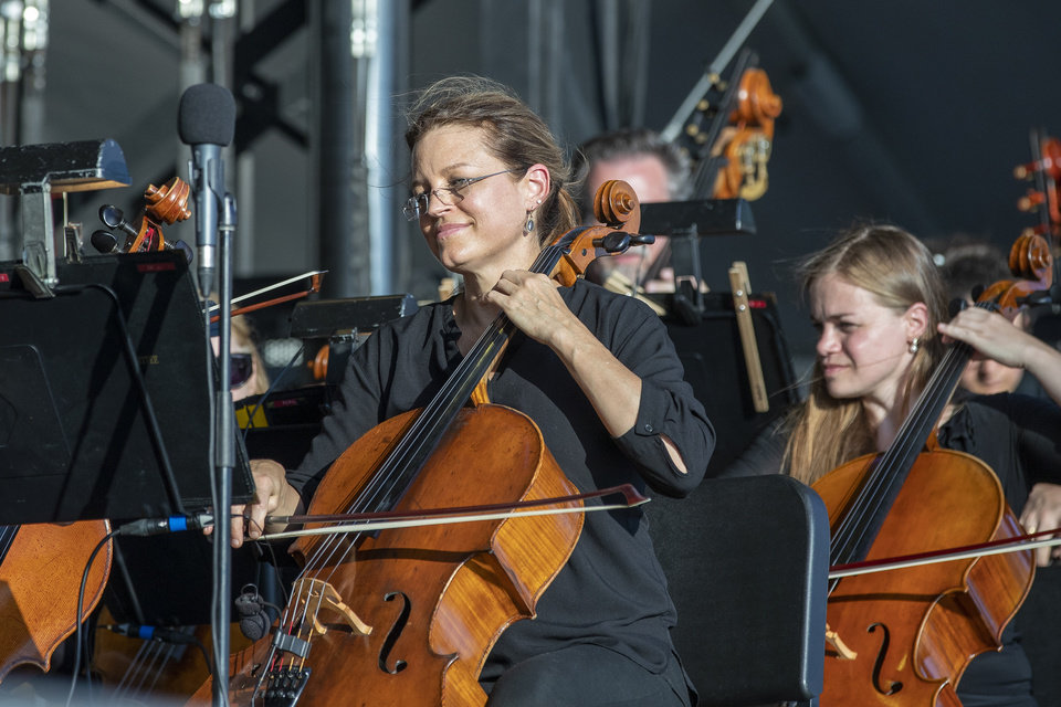 Photo - A member of the Oklahoma City Philharmonic Orchestra plays during their performance at the grand opening weekend of Scissortail Park in Oklahoma City, Sunday, Sept. 29, 2019. (Alonzo Adams for The Oklahoman)