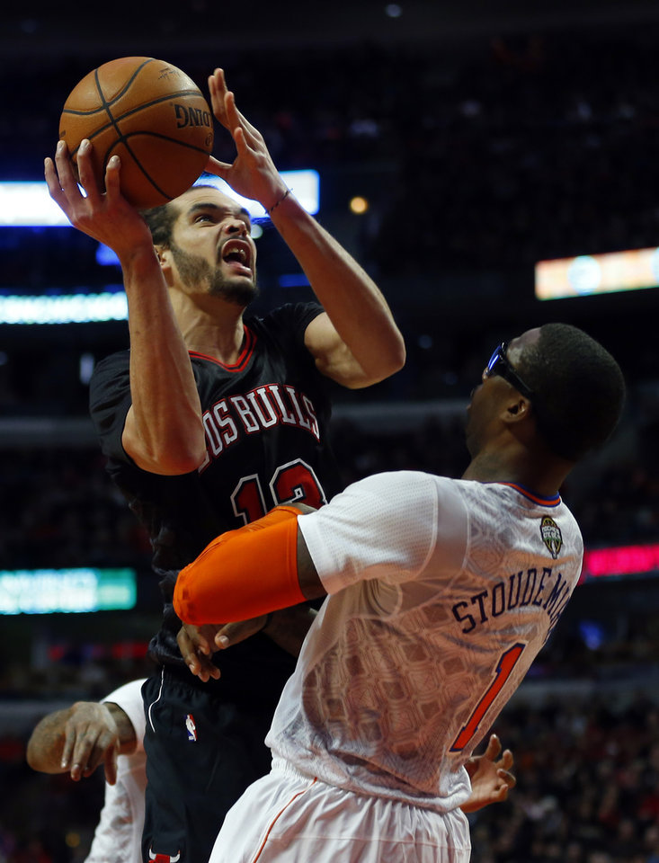 Photo - Chicago Bulls center Joakim Noah, left,shoots over New York Knicks power forward Amar'e Stoudemire (1) during the second half of an NBA basketball game on Sunday, March 2, 2014, in Chicago. The Bulls won the game 109-90. (AP Photo/Jeff Haynes)