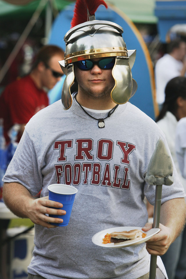 Trojan fan Alex Piper participates in  pre-game activities before the college football game between the Troy University Trojans and the Oklahoma State University Cowboys at Movie Gallery Veterans Stadium in Troy, Ala., Friday, September 14, 2007. BY STEVE SISNEY, THE OKLAHOMAN