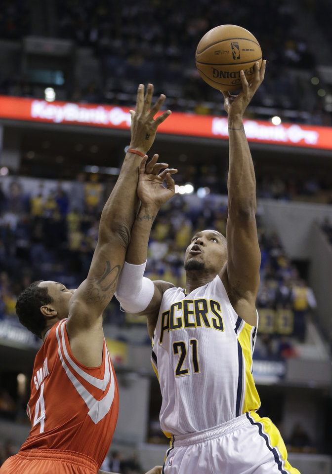 Indiana Pacers' David West (21) puts up a shot over Houston Rockets' Greg Smith (4) during the second half of an NBA basketball game Friday, Jan. 18, 2013, in Indianapolis. The Pacers defeated the Rockets 104-93. (AP Photo/Darron Cummings)