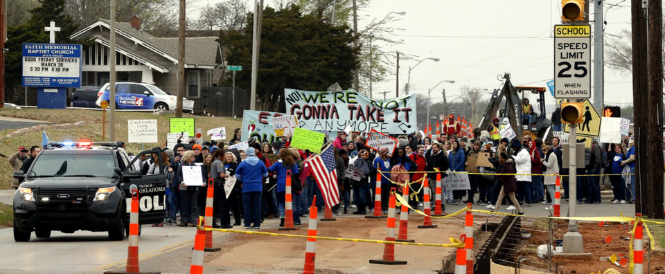 Photo -  Oklahoma City Public Schools teachers and others march from Northeast Academy to the state Capitol on Monday to protest education funding. [Photo by Steve Sisney, The Oklahoman]