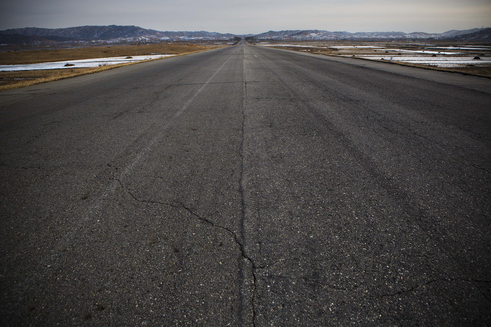 Photo - In this Feb. 24, 2013 photo, a highway on the outskirts of Pyongyang, North Korea is empty of traffic. (AP Photo/David Guttenfelder)
