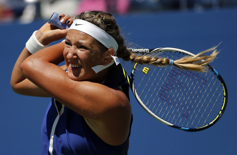 Photo - Victoria Azarenka, of Belarus, returns a shot to Christina McHale, of the United States, during the second round of the 2014 U.S. Open tennis tournament, Thursday, Aug. 28, 2014, in New York. (AP Photo/Elise Amendola)