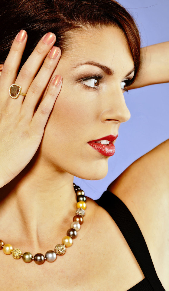 Photo - This ring features a 2-carat diamond slice. It is paired with a Tahitian South Sea pearl strand strung with pave diamond spheres. Jewelry sold at BC Clark Jewelers. Model is Alexandra. Makeup by Shellie Pickens for The Makeup Bar.  Photo by Chris Landsberger, The Oklahoman.  CHRIS LANDSBERGER