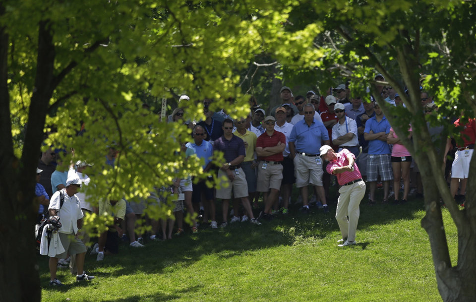 Photo - Steve Stricker hits to the second green during the second round of the Memorial golf tournament Friday, May 30, 2014, in Dublin, Ohio. (AP Photo/Darron Cummings)