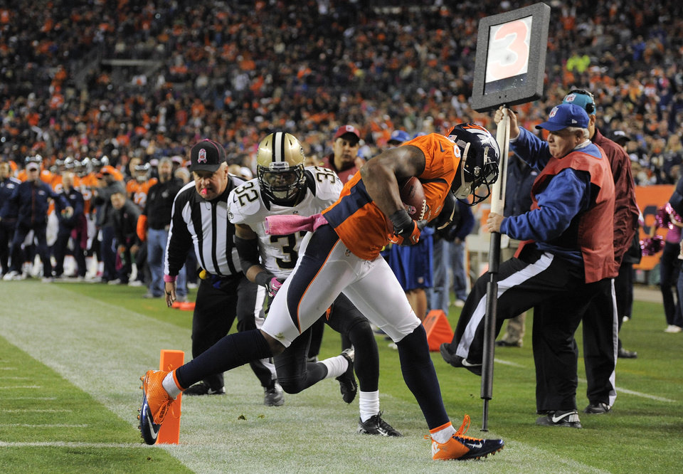 Photo -   Denver Broncos wide receiver Demaryius Thomas (88) comes down with a pass for a touchdown as New Orleans Saints defensive back Johnny Patrick (32) defends in the third quarter of an NFL football game, Sunday, Oct. 28, 2012, in Denver. (AP Photo/Jack Dempsey)