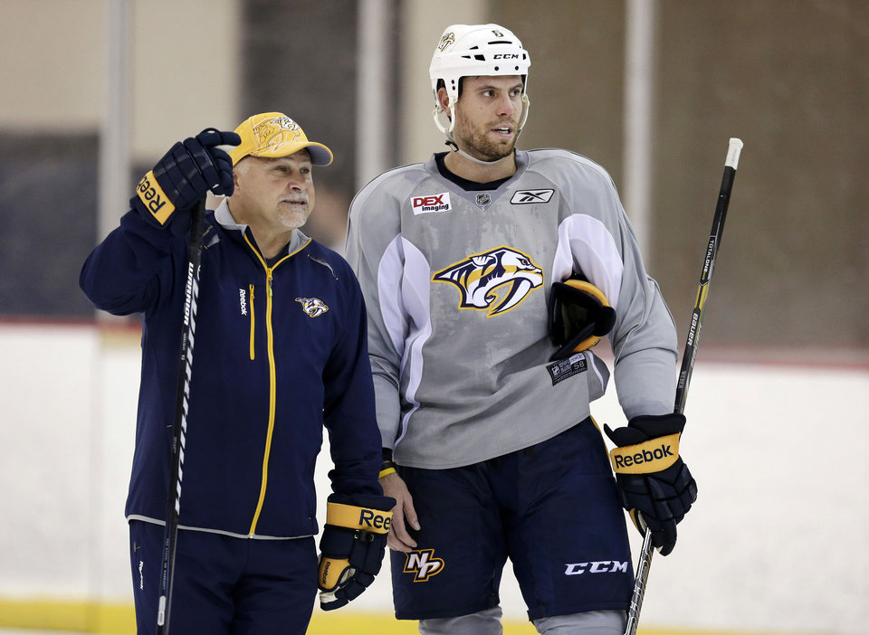 Photo - FILE - In this Sept. 13, 2013, file photo, Nashville Predators head coach Barry Trotz talks with defenseman and team captain Shea Weber, right, during an NHL hockey training camp in Nashville, Tenn. The Predators announced Monday, April 14, 2014, that Trotz's contract will not be renewed and the team will begin looking for a new head coach. (AP Photo/Mark Humphrey, File)