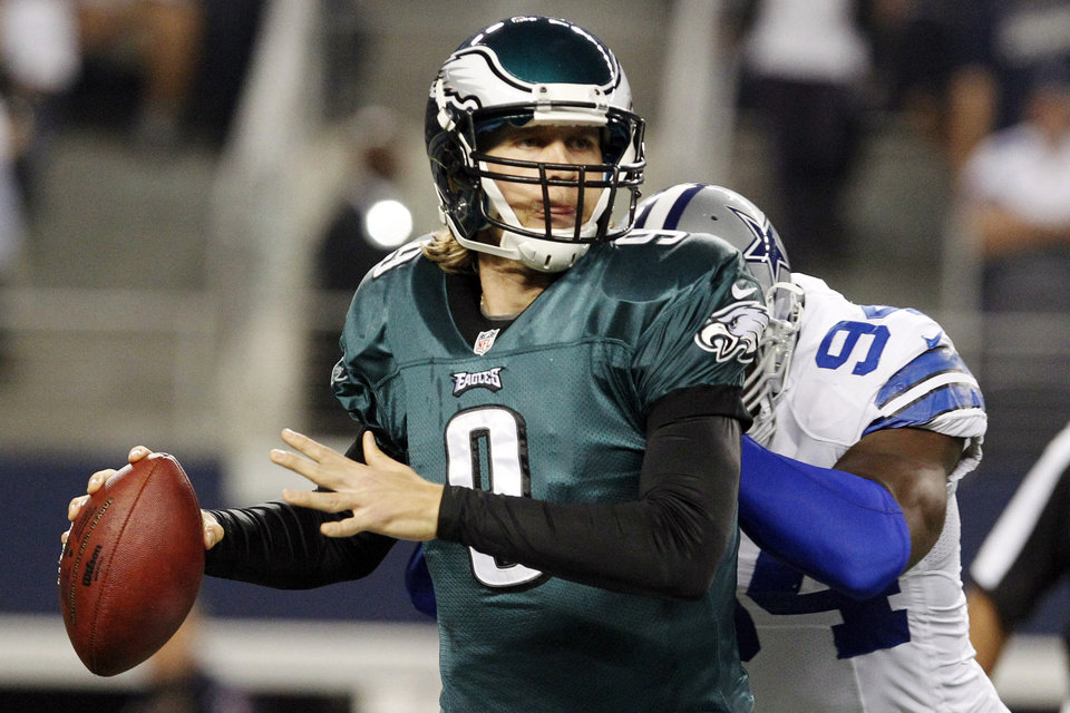 Photo - Philadelphia Eagles quarterback Nick Foles (9) is hit by Dallas Cowboys outside linebacker DeMarcus Ware (94) during the first half of an NFL football game, Sunday, Dec. 2, 2012, in Arlington, Texas. (AP Photo/LM Otero)