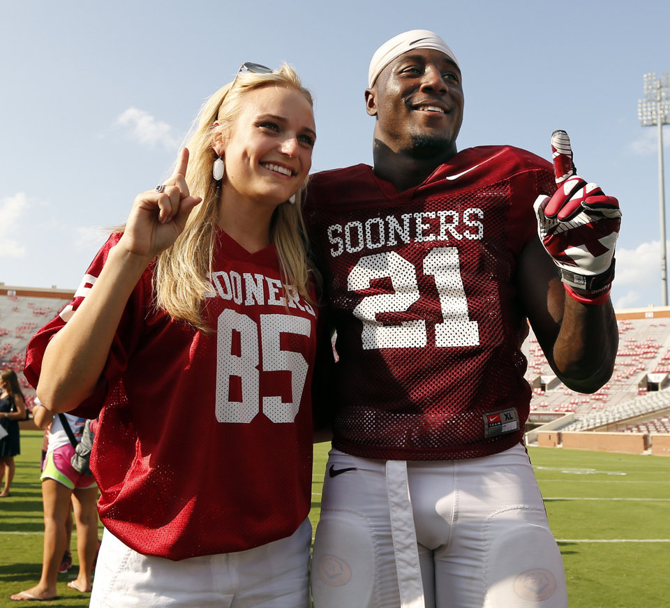 Photo - Natalie Peters, Katy, Texas, and running back Keith Ford pose for a picture during the University of Oklahoma Sooners (OU) practice and Student Day at Gaylord Family-Oklahoma Memorial Stadium in Norman, Okla., on Thursday, Aug. 21, 2014. Photo by Steve Sisney, The Oklahoman