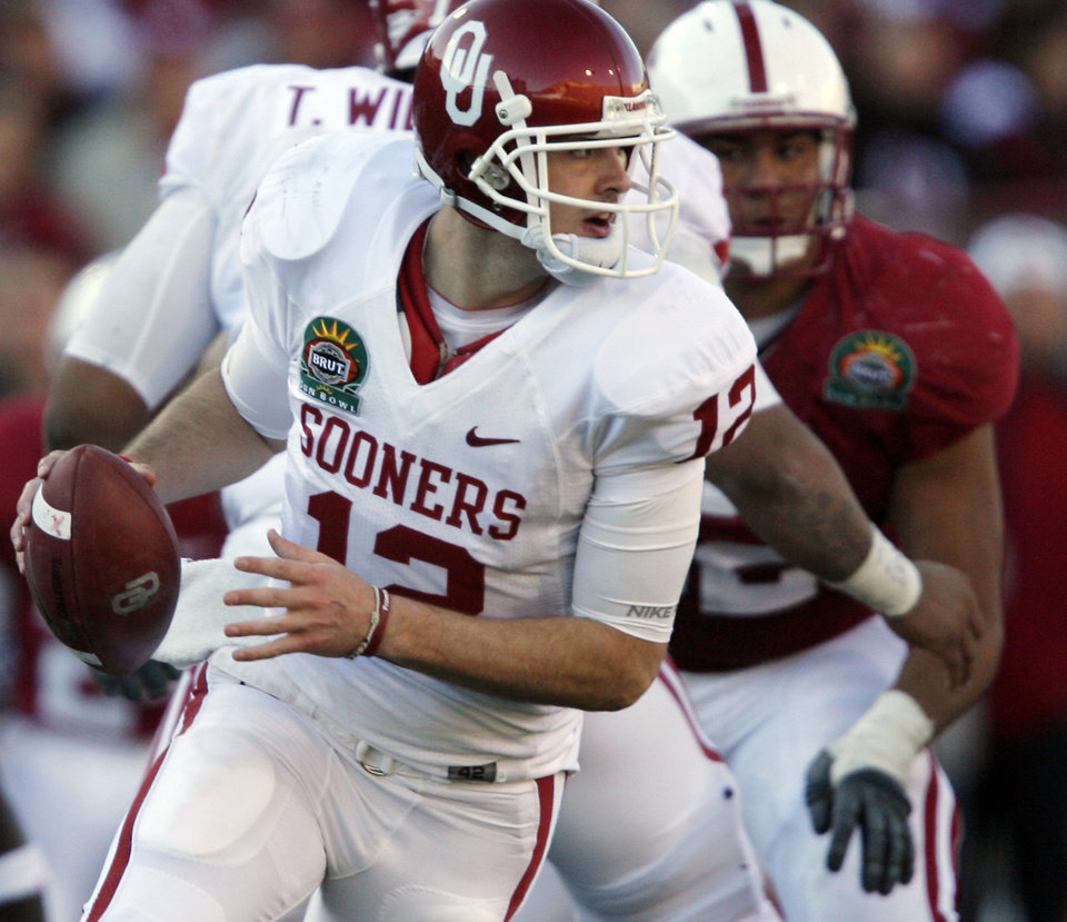 Oklahoma's Landry Jones (14) rolls out of the pocket during the second half of the Brut Sun Bowl college football game between the University of Oklahoma Sooners (OU) and the Stanford University Cardinal on Thursday, Dec. 31, 2009, in El Paso, Tex.   Photo by Chris Landsberger, The Oklahoman