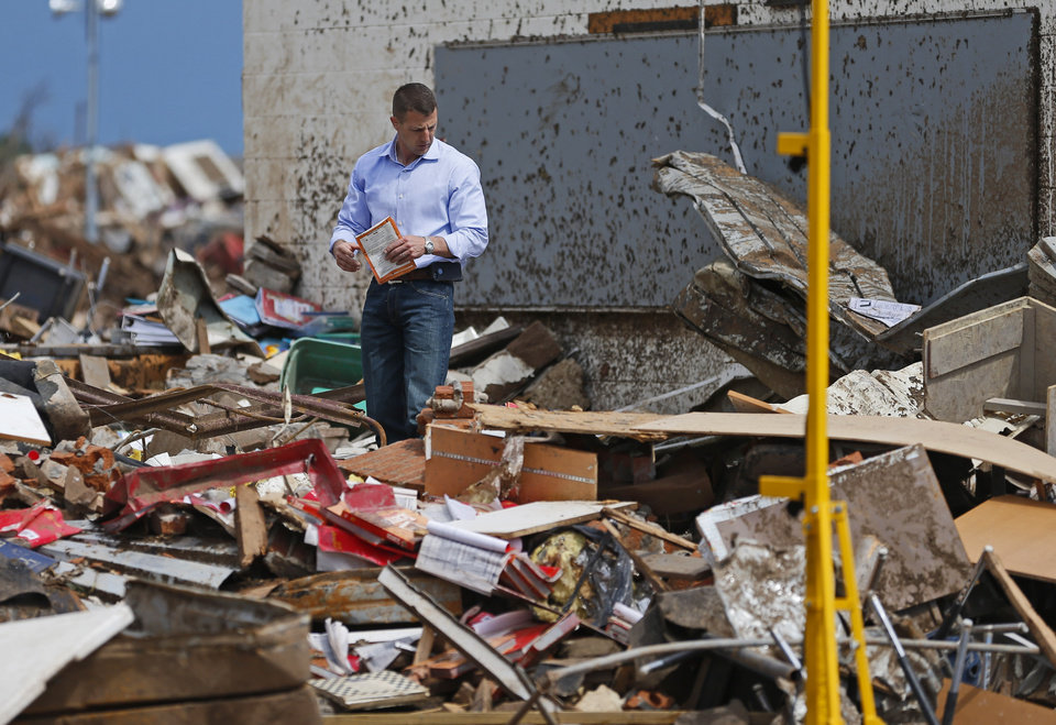 Rep. Markwayne Mullin looks through debris at the Plaza Towers Elementary School in Moore, Okla., on Tuesday, May 21, 2013. A tornado hit the area on Monday, May 20, 2013. Photo by Bryan Terry, The Oklahoman