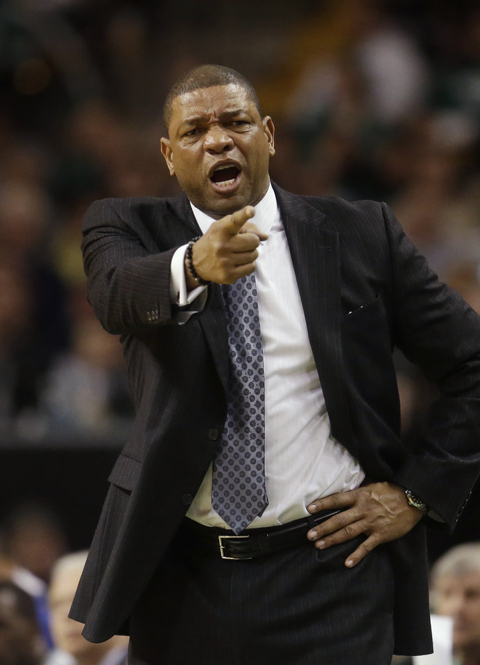 Boston Celtics head coach Doc Rivers shouts from the bench during the first half of an NBA basketball game against the Miami Heat at the TD Garden in Boston, Sunday, Jan. 27, 2013. The Celtics defeated the Heat 100-98. (AP Photo/Steven Senne)