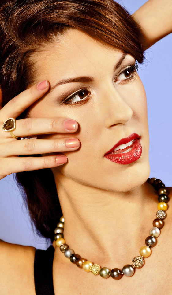 This ring features a 2-carat diamond slice. It is paired with a Tahitian South Sea pearl strand strung with pave diamond spheres. Jewelry sold at BC Clark Jewelers. Model is Alexandra. Makeup by Shellie Pickens for The Makeup Bar.  Photo by Chris Landsberger, The Oklahoman. <strong>CHRIS LANDSBERGER</strong>