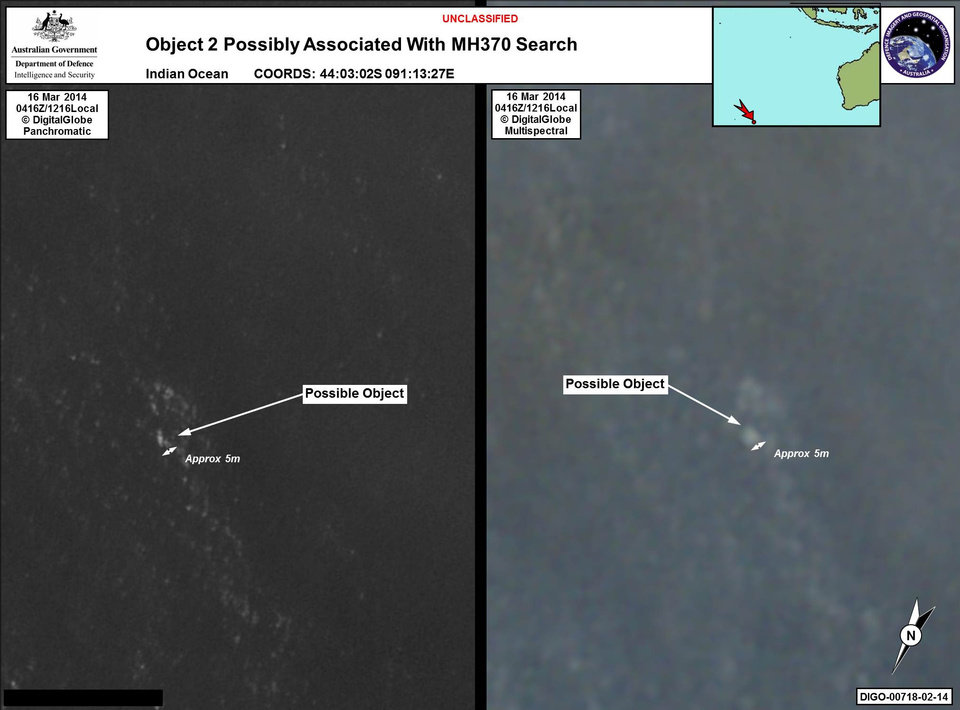 Photo - In this March 16, 2014 satellite imagery provided by Commonwealth of Australia - Department of Defence on Thursday, March 20, 2014, a floating object is seen at sea next to the descriptor which was added by the source. Australia's government reported Thursday, March 20, 2014 that the images show suspected debris from the missing Malaysia Airlines jetliner floating in an area 2,500 kilometers (1,550 miles) southwest of Perth Australia. (AP Photo/Commonwealth of Australia - Department of Defence)