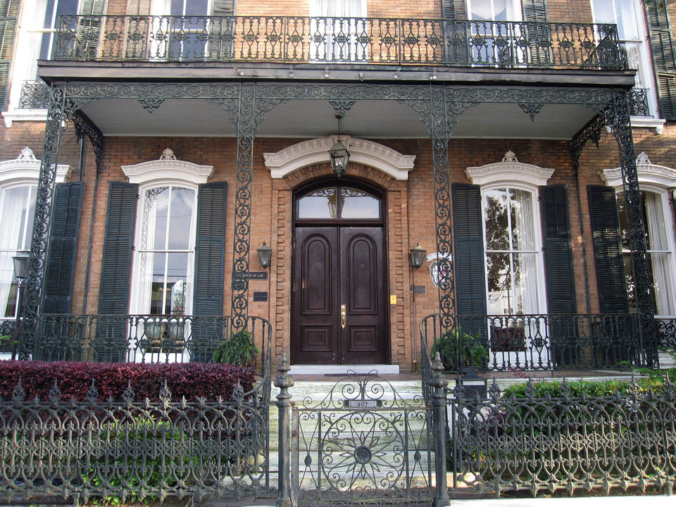 Photo - This 2012 photo shows a home with ornate ironwork fencing and a balcony in Mobile, Alabama. The city's downtown streets are lined with homes and businesses decorated with the picturesque lacy-patterned ironwork. (AP Photo/Beth J. Harpaz)