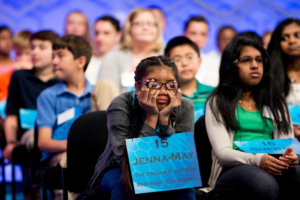 Photo - Jenna-May Ingal, 14, of Riverside, Calif. struggles to stay away during the 2015 Scripps National Spelling Bee, Wednesday, May 27, 2015, in Oxon Hill, Md. (AP Photo/Andrew Harnik)