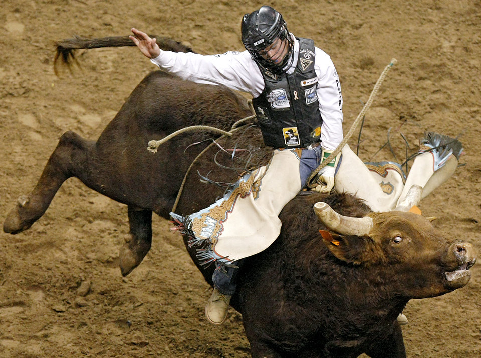 OKLAHOMA CITY ARENA: Cord McCoy rides Filibuster during the PBR (Professional Bull Riders) 2011 Built Ford Tough Series event at the OKC Arena in Oklahoma City on Sunday, Feb. 13, 2011. Photo by John Clanton, The Oklahoman ORG XMIT: KOD