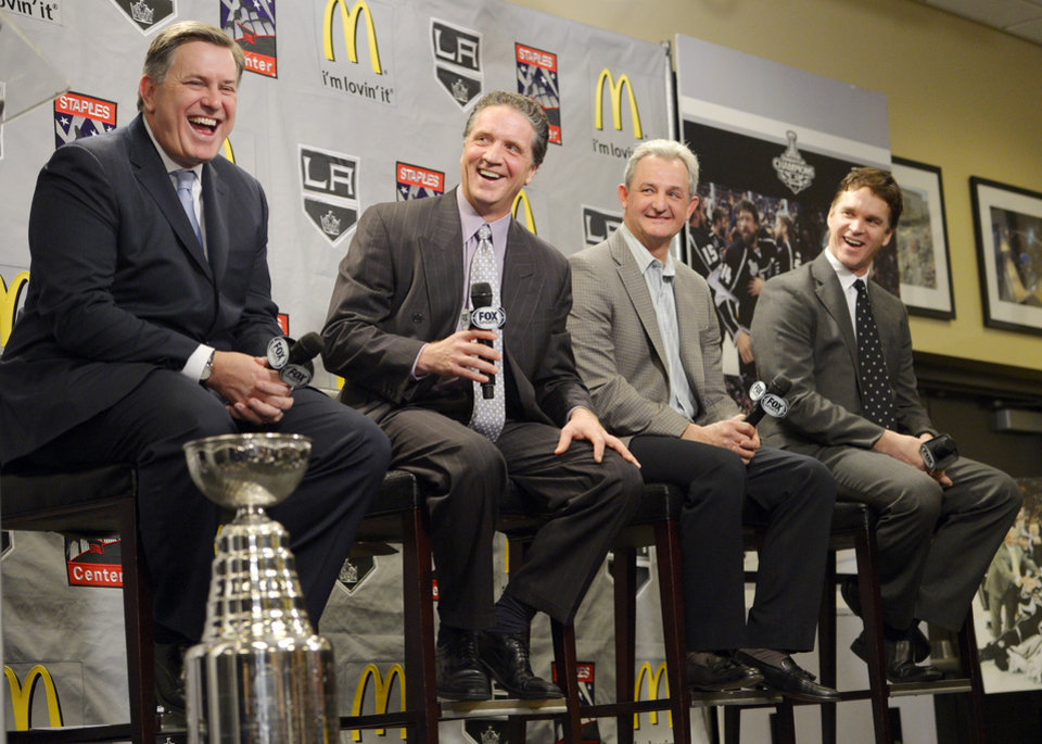 From left, Tim Leiweke, president and CEO of Anschutz Entertainment Group, which owns the Los Angeles Kings, President and general manager Dean Lombardi, head coach Darryl Sutter and president of business operations Luc Robitaille laugh during a news conference to help kick off the NHL hockey team's upcoming season, Thursday, Jan. 10, 2013, in Los Angeles. (AP Photo/Mark J. Terrill)
