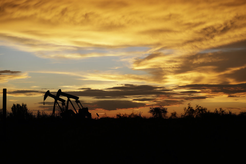 "Photo - FILE- In this June 5, 2017, file photo pumpjacks work in an oil field at sunset after a thunderstorm passed through the area in Karnes City, Texas. The United States may have reclaimed the title of the world's biggest oil producer sooner than expected. The U.S. Energy Information Administration said Wednesday that America ""likely surpassed"" Russia in June and August after jumping over Saudi Arabia earlier this year. (AP Photo/Eric Gay, File)"