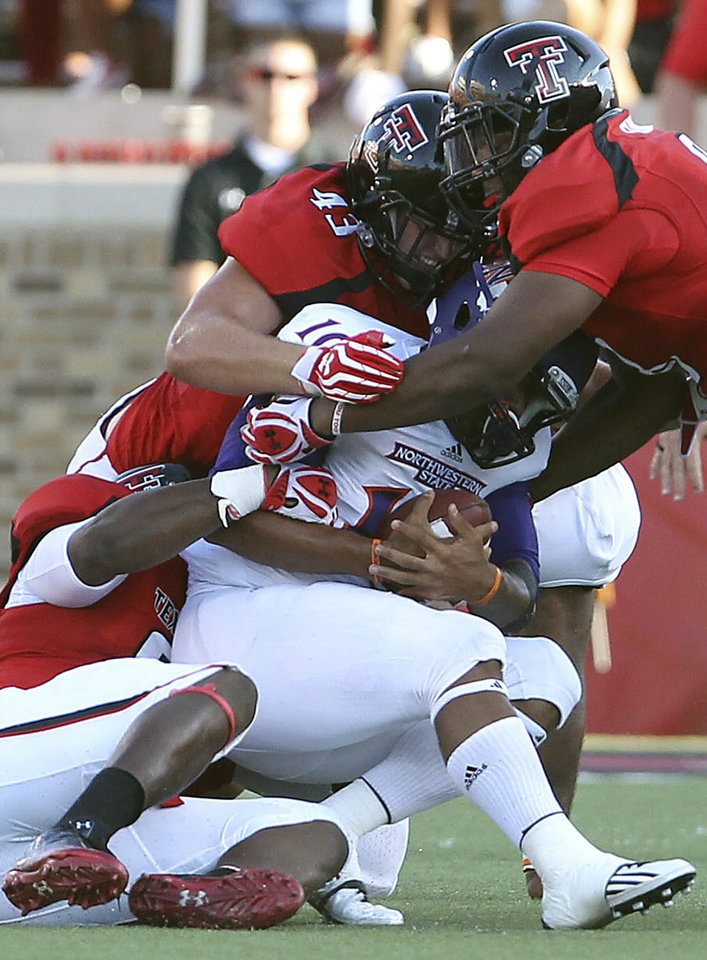 Photo -   FILE - In this Sept. 1, 2012, file photo, Northwestern State's Brad Henderson is taken down by Texas Tech's Kerry Hyder,left, Jackson Richards(43) and Delvon Simmons, right, during their NCAA college football game in Lubbock, Texas. Texas Tech has long been known for slinging passes all over the Big 12. No longer, at least through Texas Tech's first three games against non-conference opponents. The Red Raiders (3-0) are No. 2 in the nation in total defense (120 yards per game) and in passing defense (85 ypg). (AP Photo/Lubbock Avalanche-Journal,Zach Long, File)