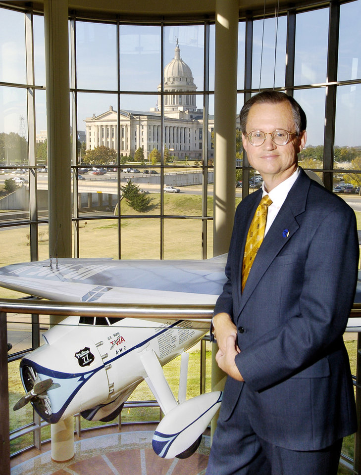 Photo - Oklahoma Historical Society Executive Director Bob Blackburn overlooking the suspended full-size reproduction of the Wiley Post plane Winnie Mae in the Devon Great Hall of the Oklahoma History Center under construction Monday Nov. 7, 2005 in Oklahoma City. The Oklahoma History Center will open this month across from the state Capitol. BY PAUL B. SOUTHERLAND, THE OKLAHOMAN