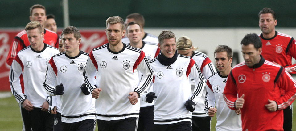 Photo - Germany's player practice during a training session prior to the international friendly soccer match between Germany and Chile in Stuttgart, southern Germany, Monday, March 3, 2014. Germany will face Chile Wednesday. (AP Photo/Matthias Schrader)