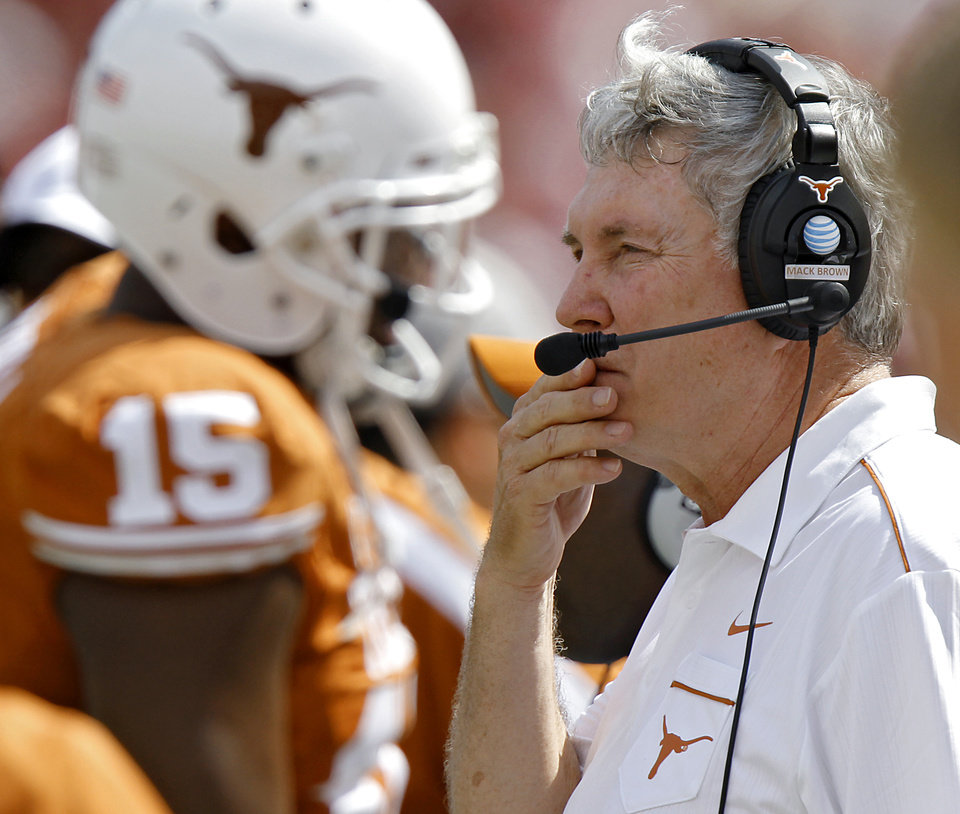 Texas coach Mack Brown looks on from the sideline during the Red River Rivalry college football game between the University of Oklahoma Sooners (OU) and the University of Texas Longhorns (UT) at the Cotton Bowl in Dallas, Saturday, Oct. 8, 2011. Photo by Chris Landsberger, The Oklahoman