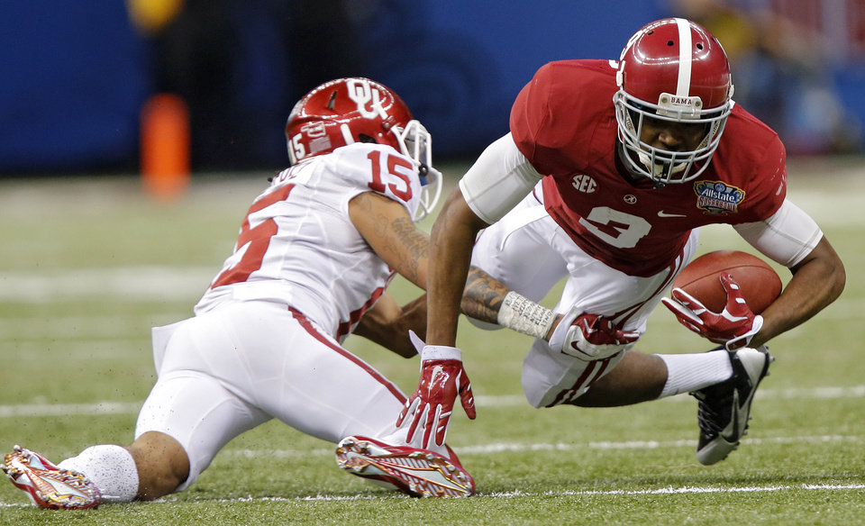 Photo - Oklahoma's Zack Sanchez (15) stops Alabama's Amari Cooper (9) during the NCAA football BCS Sugar Bowl game between the University of Oklahoma Sooners (OU) and the University of Alabama Crimson Tide (UA) at the Superdome in New Orleans, La., Thursday, Jan. 2, 2014.  .Photo by Chris Landsberger, The Oklahoman
