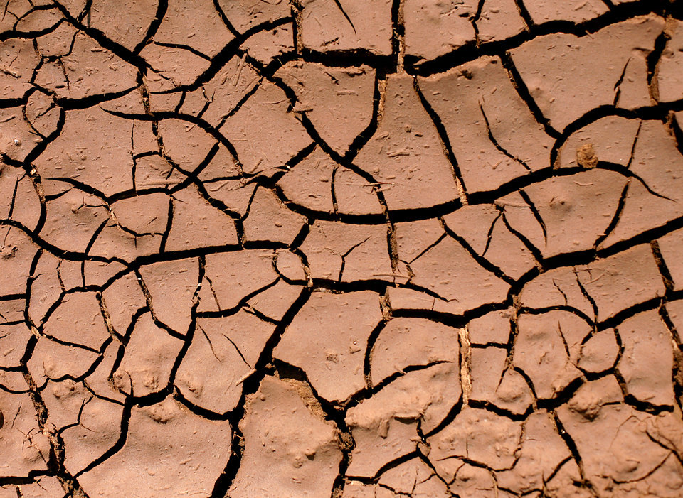 Dry soil cracks in the heat near Lake Hefner in Oklahoma City on Monday, July 18, 2011. Photo by John Clanton, The Oklahoman
