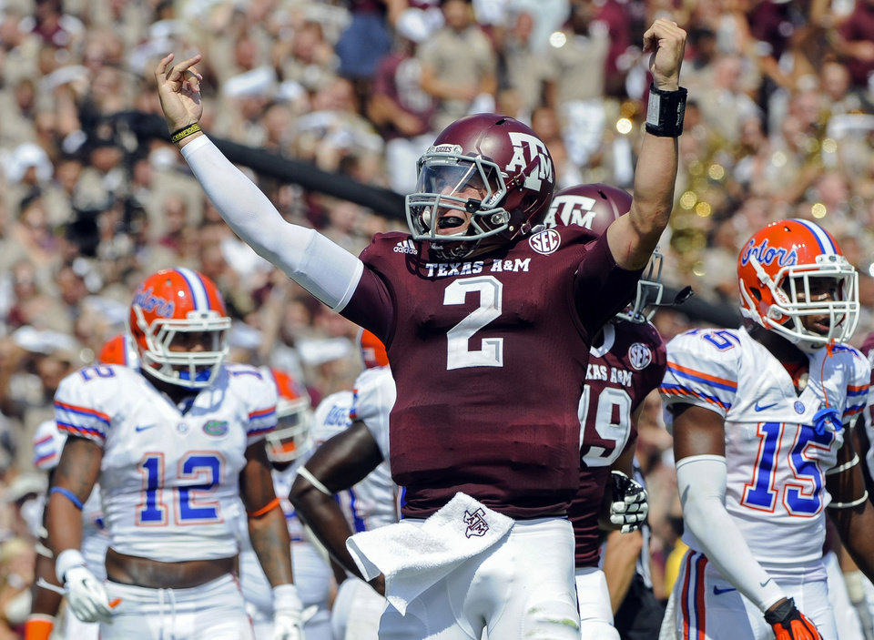 Photo - Texas A&M's Johnny Manziel (2) reacts after a touchdown run during the second quarter of an NCAA college football game against Florida in College Station, Texas. Manziel could become the first freshman to win the Heisman Trophy when the award is presented Saturday, Dec. 8, 2012, in New York. (AP Photo/Dave Einsel, File)
