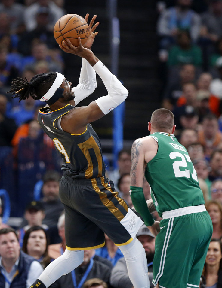 Photo - Oklahoma City's Nerlens Noel (9) shoots over Boston's Daniel Theis (27) in the first quarter during an NBA basketball game between the Oklahoma City Thunder and the Boston Celtics at Chesapeake Energy Arena in Oklahoma City, Sunday, Feb. 9, 2020. [Nate Billings/The Oklahoman]