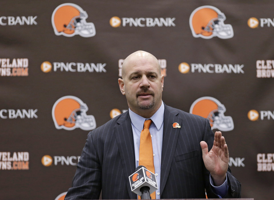 Photo - Cleveland Browns head coach Mike Pettine answers questions during  news-conference Thursday, Jan. 23, 2014, in Berea, Ohio. The Browns flew to Mobile, Ala., on Tuesday to interview Pettine for the second time at the Senior Bowl. The four-hour meeting came shortly after Gase, the first candidate the team contacted, called Browns owner Jimmy Haslam and withdrew from consideration. (AP Photo/Tony Dejak)