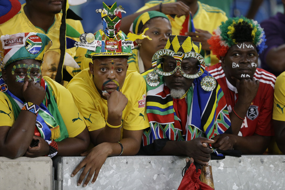 South Africa fans react as their team is knocked out of the African Cup of Nations tournament after losing to Mali on penalties in their quarterfinal soccer match, at Moses Mabhida Stadium in Durban, South Africa, Saturday, Feb. 2, 2013. (AP Photo/Rebecca Blackwell)