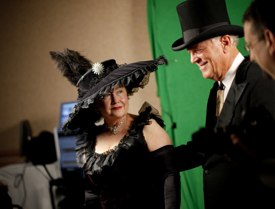 Photo - After getting their photo taken, Gary and Nancy Orendorff look for their table during a Titanic-themed fundraiser for the Rose State scholarship fund.  Photo by Bryan Terry, The Oklahoman