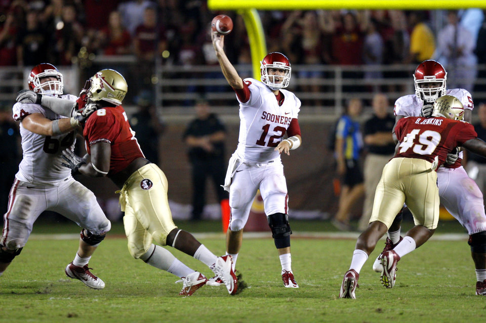 Oklahoma's Landry Jones (12) throws a pass during a college football game between the University of Oklahoma (OU) and Florida State (FSU) at Doak Campbell Stadium in Tallahassee, Fla., Saturday, Sept. 17, 2011.Oklahoma won 23-13.  Photo by Bryan Terry, The Oklahoman