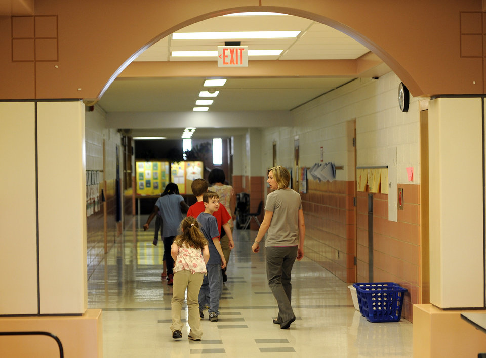 A third grade class walks down the hallway after finishing the ISTEP test at Emmons Elementary School in Mishawaka, Ind. Wednesday May 1, 2013. Issues with the computer based testing program have caused some problems with the ISTEP test.  The Indiana Department of Education said in a statement that administration of the ISTEP+ exams' online portion resumed Wednesday morning, but that schools are being asked to decrease their daily test load to 50 percent of normal levels until further notice. (AP Photo/Joe Raymond)