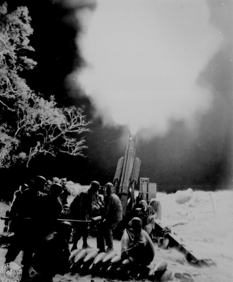 Photo - Artillery men of the `C' Battery, 90th Field Artillery, lay down a murderous barrage on troublesome Jap artillery positions in Balete Pass, Luzon, P.I.