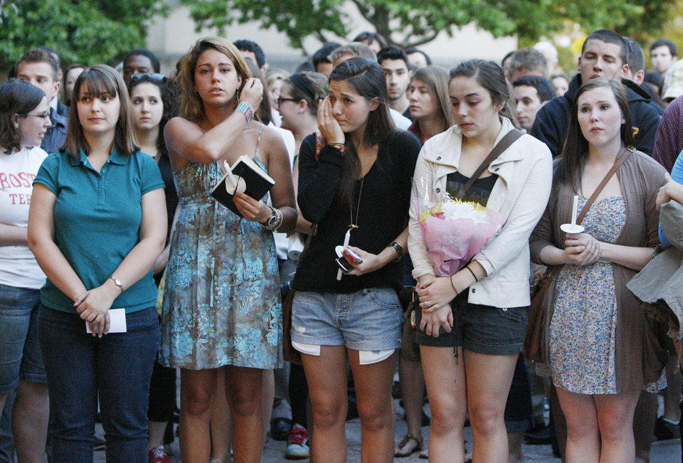 Photo -   Boston University students hold a candlelight vigil on Marsh Plaza at Boston University, Saturday, May 12, 2012, to mourn for three students studying in New Zealand who were killed when their minivan crashed during a weekend trip. Daniela Lekhno, 20, of Manalapan, N.J.; Austin Brashears, 21, of Huntington Beach, Calif.; and Roch Jauberty, 21, whose parents live in Paris, were killed as they traveled in a minivan Saturday near the North Island vacation town of Taupo when the vehicle drifted to the side of the road and then rolled when the driver tried to correct course. (AP Photo/Bizuayehu Tesfaye)