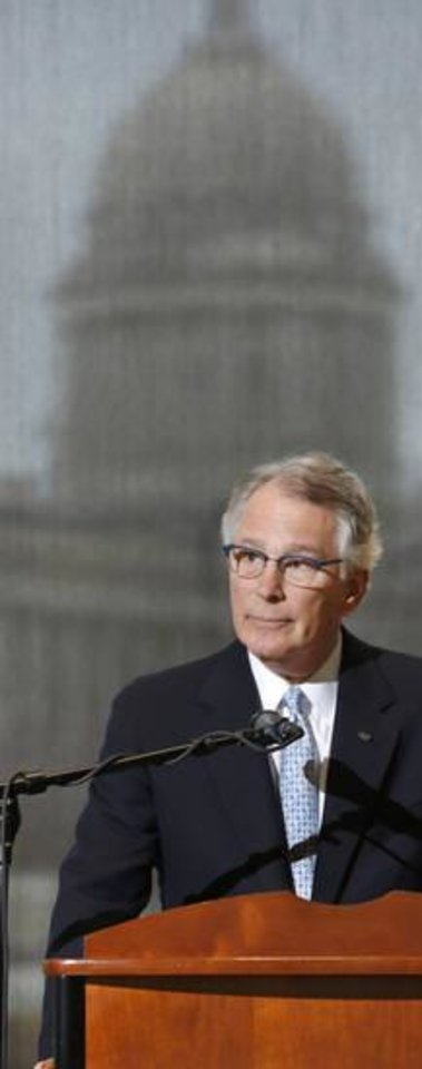 Photo -  David Rainbolt, an Oklahoma banker, discusses a proposed package of reforms developed by a coalition of Oklahoma business and civic leaders during a news conference Thursday in the atrium of the Oklahoma History Center. The state Capitol can be seen in the background. [Photo by Jim Beckel, The Oklahoman]