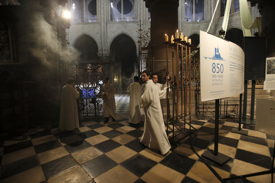 Religious dignitaries attend a ceremony at Paris\' Notre Dame Cathedral for its 850th anniversary , Wednesday, Dec. 12, 2012. Paris\' Notre Dame Cathedral is kicking off its 850th anniversary celebrations, which will include new bells for the medieval landmark, cast in a foundry in Normandy. (AP Photo/Christophe Ena) ORG XMIT: ENA113