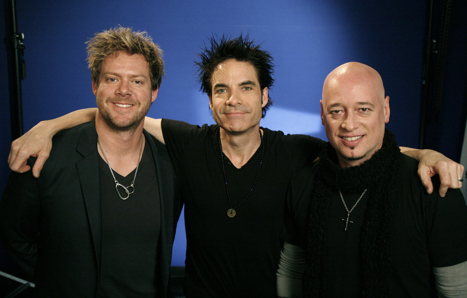 "In this Dec. 15, 2010 photo, the recording group ""Train"" from left to right, Scott Underwood, Patrick Monahan and Jimmy Stafford pose for a portrait in New York.  (AP Photo/Jeff Christensen) ORG XMIT: NYJC203"