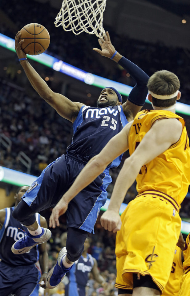 Dallas Mavericks' Vince Carter (25) shoots against Cleveland Cavaliers' Tyler Zeller in the first quarter of an NBA basketball game on Saturday, Nov. 17, 2012, in Cleveland. (AP Photo/Mark Duncan)