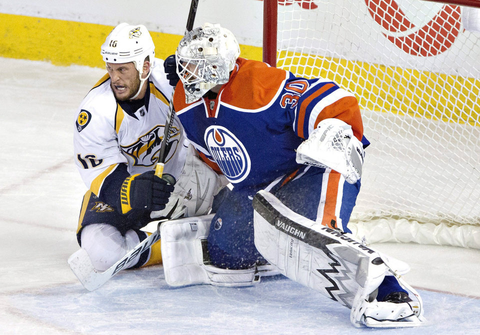 Photo - Nashville Predators Rich Clune (16) tries to screen Edmonton Oilers goalie Ben Scrivens (30) during third period of an NHL hockey game in Edmonton, Alberta, Sunday, Jan. 26, 2014. (AP Photo/The Canadian Press, Jason Franson)