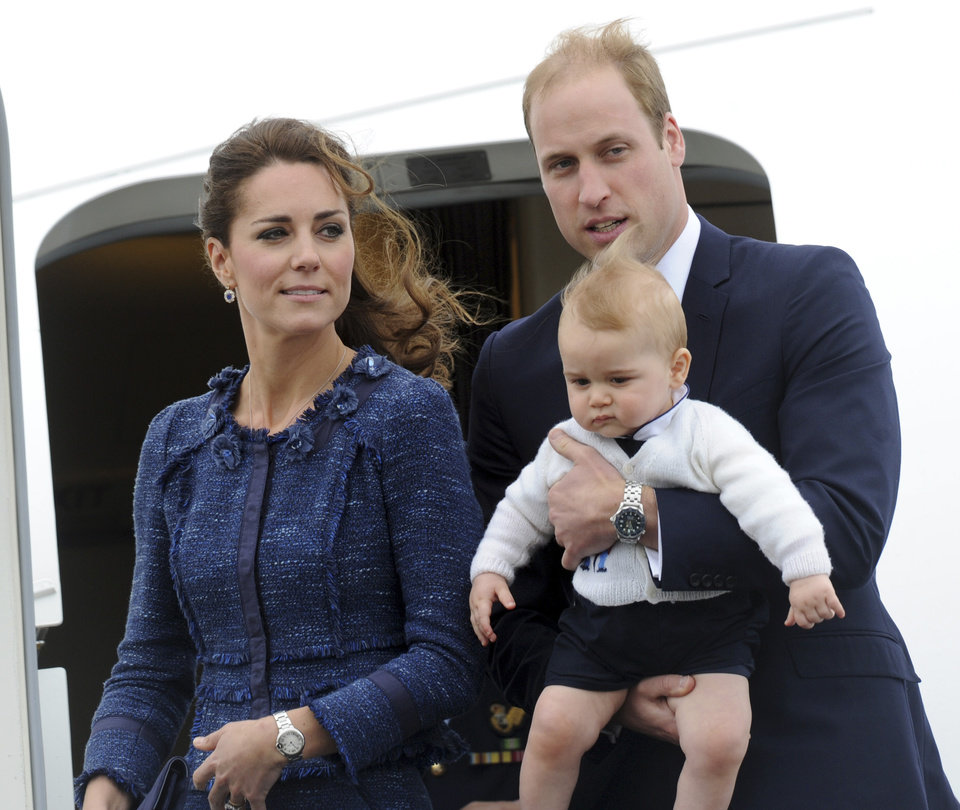 Photo -  Britain's Prince William carries Prince George with Catherine, Duchess of Cambridge as they depart on an RAAF plane bound for Sydney, Wellington, New Zealand, Wednesday, April 16, 2014.   Wellington, New Zealand, Wednesday, April 016, 2014. (AP Photo/SNPA, Ross Setford) **NEW ZEALAND OUT**